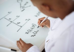 Person working on a math problem.